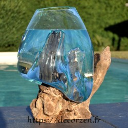 Aquarium ou bol à punch en verre recyclé fondu puis soufflé en fusion sur une racine de bois flotté, le verre est amovible.